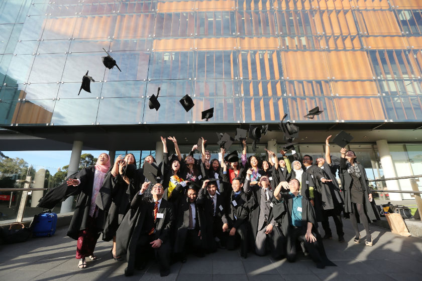 Australia Awards Scholarships recipients happily celebrate their graduation