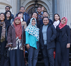 A group of scholars from Indonesia posing for photograph in front of Parliament House Melbourne