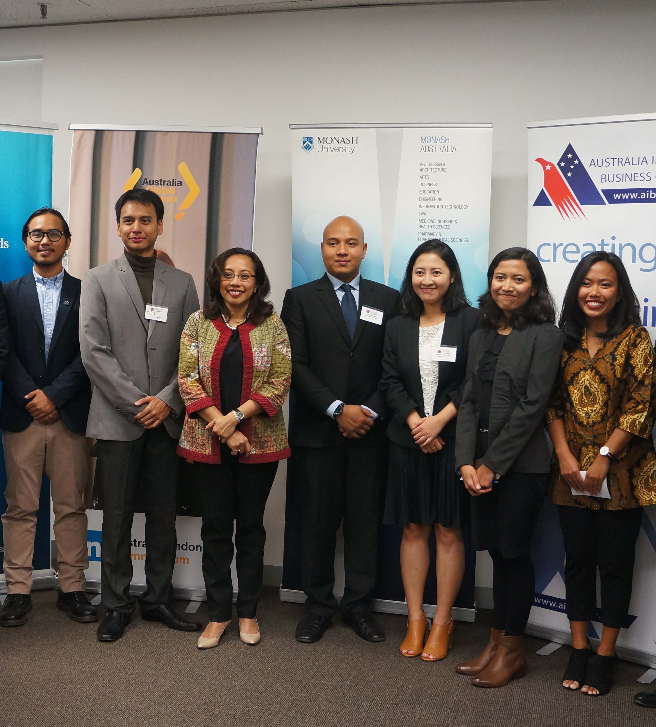 A group of Australia Awards scholars and staff smile and pose together during an On-Awards enrichment acvitiy in Melbourne.