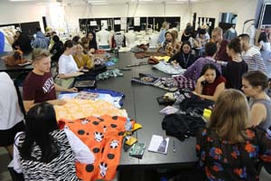 A fashion design studio full of students